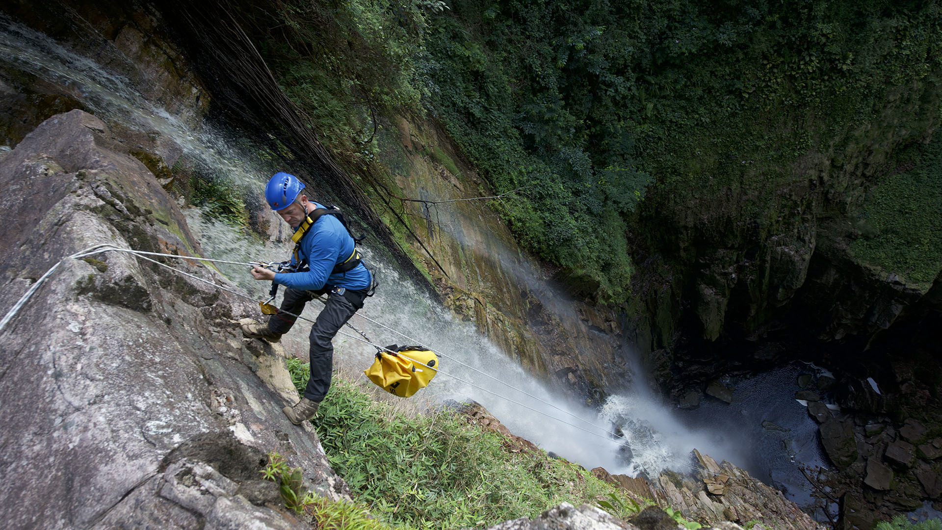 Image of Steve Backshall abseiling.