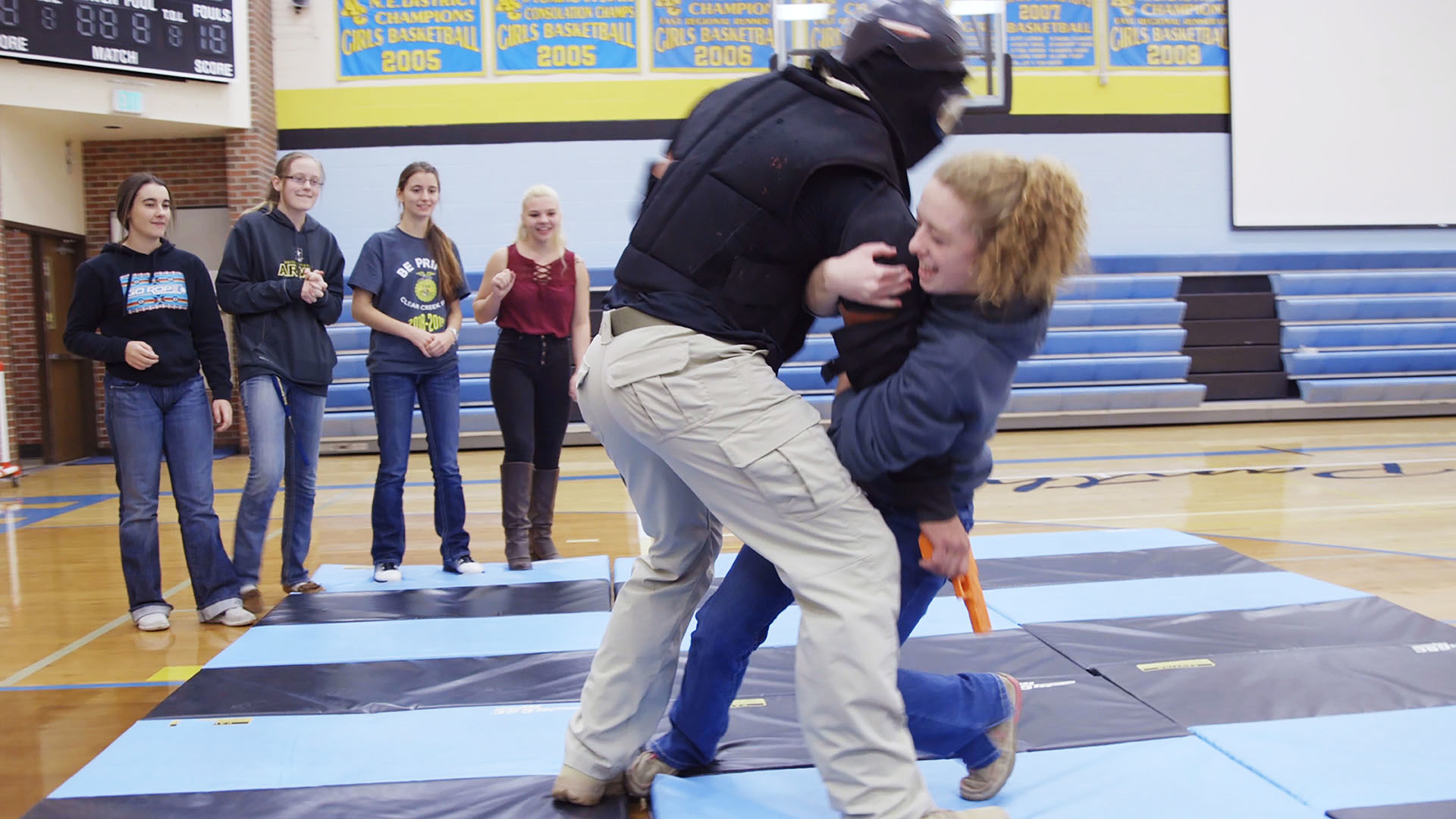 The drills we observed in Wyoming increased in escalation as the students got older. Here, a high school student was asked to practice tackling a trainer armed with a fake gun.