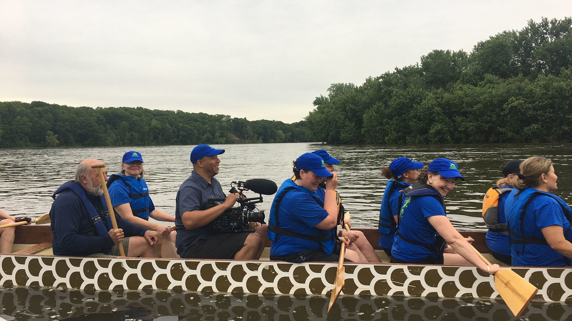 Cinematographer Corey Lillard films the Paradise City Dragon Boat team from inside the boat.